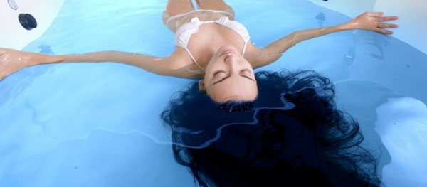 Woman Floating In A Sensory Deprivation Float Tanks
